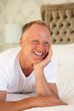 Man Relaxing In Bedroom Royalty Free Stock Photography