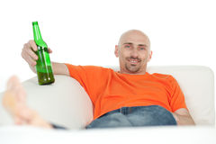 Man relaxing with beer bottle stock photography