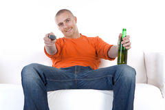 Man relaxing with beer on sofa royalty free stock photography