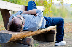 Man relaxing on bench Royalty Free Stock Image