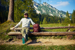 Man relaxing on the bench after mountainous walk Stock Image