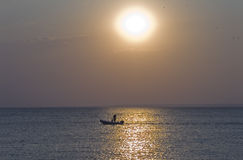 Man relaxing on a boat at Sunset. A man relaxing on a boat at Sunset royalty free stock images