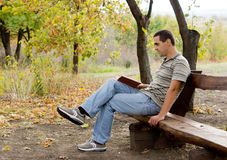 Man relaxing with a book Stock Image