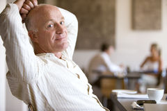 Man relaxing in cafe Stock Images