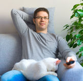 Man relaxing with cat. Stock Photo