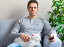 Man relaxing with cat. Royalty Free Stock Photography