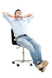 Man relaxing in chair Royalty Free Stock Image