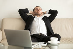 Man relaxing after completing an important work Stock Image