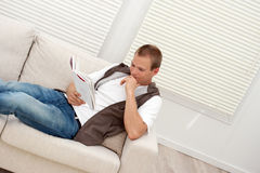 Man relaxing on the couch Royalty Free Stock Photography