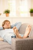 Man relaxing on couch Stock Image