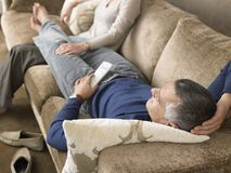 Man Relaxing On Couch Royalty Free Stock Image