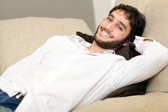 Man relaxing on the couch Stock Photography