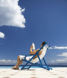 A man relaxing in a deck chair Royalty Free Stock Photos