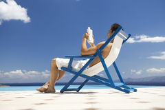 A man relaxing in a deck chair Stock Photography