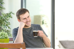 Man relaxing drinking coffee at home balcony Stock Image