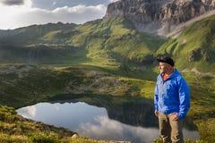 Man relaxing and enjoying beautiful summer mountain landscape Stock Photography