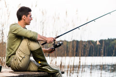 Man relaxing fishing or angling at lake Royalty Free Stock Photos