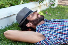 Man relaxing on grass Stock Images
