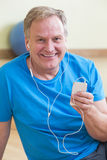 Man relaxing after gym workout Royalty Free Stock Photos