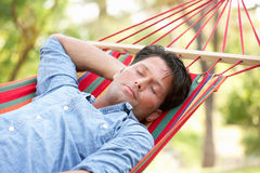 Man Relaxing In Hammock Stock Photos