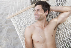A man relaxing in a hammock Stock Images