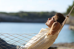 Man relaxing on a hammock in the beach Stock Images