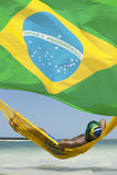 Man Relaxing in Hammock on Brazilian Beach Royalty Free Stock Image