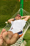 Man relaxing on the hammock Stock Photography