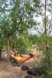 Man Relaxing In Hammock. In the forest Stock Photography