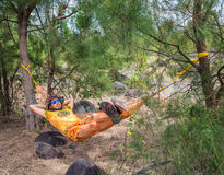 Man Relaxing In Hammock. In the forest Stock Photo