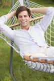 Man relaxing in hammock smiling royalty free stock photos