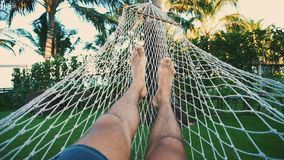 Man relaxing on the hammock stock video