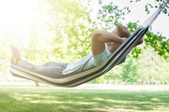 Man Relaxing In Hammock. Young Man Relaxing In Hammock At Park Stock Image