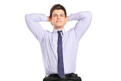 Man relaxing with the hands behind his head Royalty Free Stock Photo