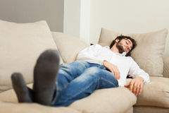 Man relaxing on his couch Stock Images