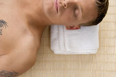 Man relaxing with his eyes closed at spa Stock Photography