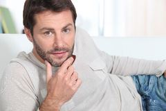 Man relaxing on his sofa Stock Photo