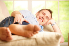 Man relaxing in home Stock Image