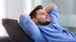 Man relaxing at home Stock Images
