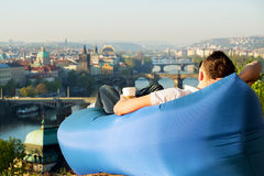 Man relaxing in an inflatable sofa Stock Photo