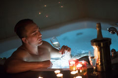 Man relaxing in the jacuzzi Stock Photos