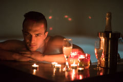 Man relaxing in the jacuzzi Stock Photography