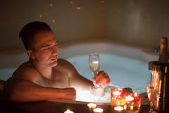 Man relaxing in the jacuzzi Stock Image