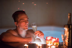 Man relaxing in the jacuzzi Stock Images