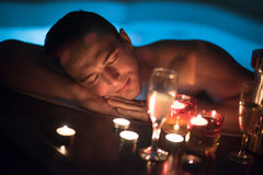 Man relaxing in the jacuzzi Stock Photo