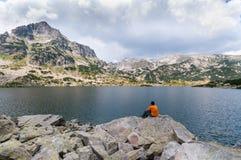 Man Relaxing on Lake Royalty Free Stock Photos