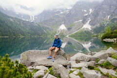 man relaxing on the lake and mountains sunny landscape Stock Photos