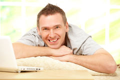 Man relaxing with laptop Royalty Free Stock Photos