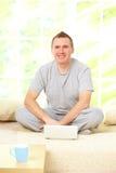 Man relaxing with laptop Stock Photos