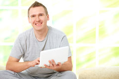 Man relaxing with laptop Royalty Free Stock Image